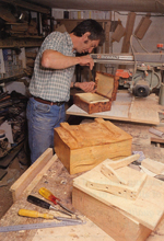 Peter Lloyd working on a box